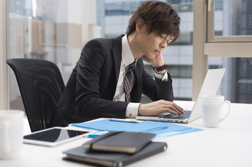 Young businessman is tired
