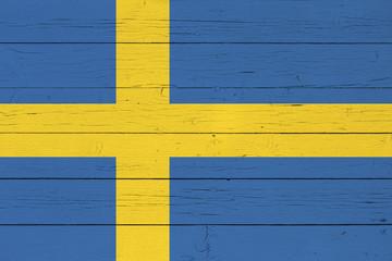 Flag of Sweden on wooden background