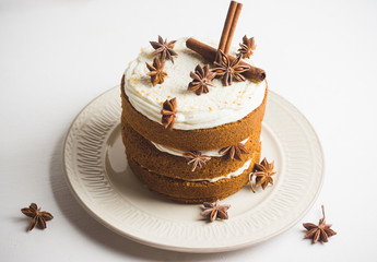 Cake with cream on the white wooden background