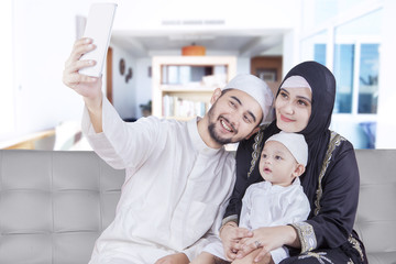 Arabic parents and their son taking selfie photo