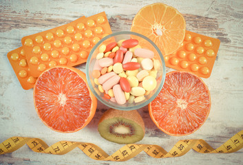 Vintage photo, Natural fruits, centimeter and pills, slimming, choice between healthy nutrition and medical supplements