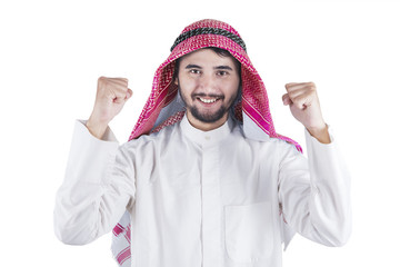 Happy Arabic man expressing his success