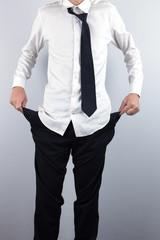 Businessman shows empty pockets