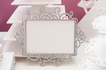 Vintage white frame on a table and place for text
