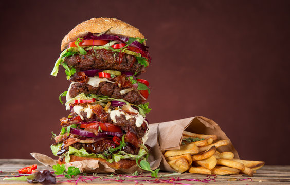 Tasty big burger on wooden table.