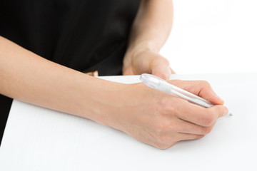 Woman hands signing a paper