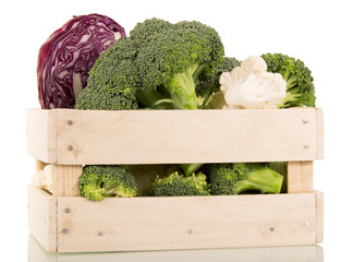 Spoed Foto op Canvas Keuken Fresh broccoli, cauliflower and red cabbage in wooden box isolated.