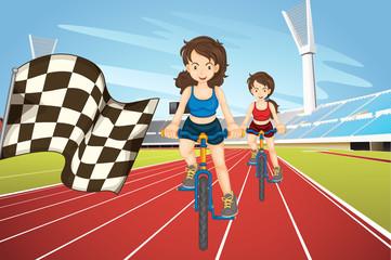 Women racing bike in the field