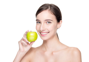 Smiling beautiful woman holding green apple