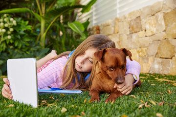 Blond kid girl selfie photo tablet pc and dog