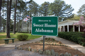 sweet home alabama welcome sign at rest area stop off highway