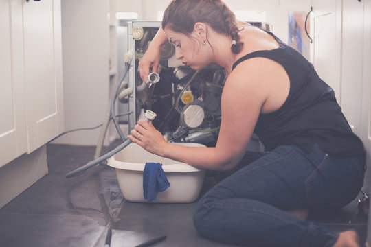 Woman trying to repair the leak