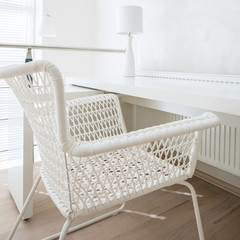 Interior of room with white wicker chair