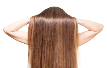 She raises her hands smooth shiny brown hair isolated.