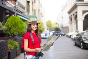 Portrait of a beautiful female tourist searching a place on the