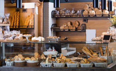 Zelfklevend Fotobehang Bakkerij Display of ordinary bakery with bread and buns