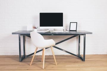 White chair and designer desk