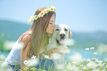 Beautiful woman with labrador on nature