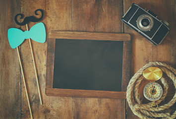 top view of blank blackboard and man's vintage accessories