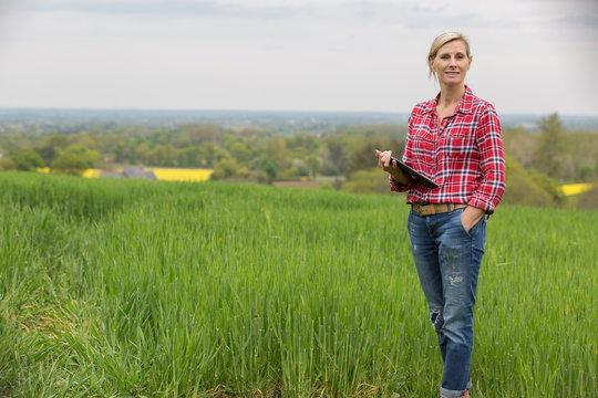 Female farmer analysing barly yield