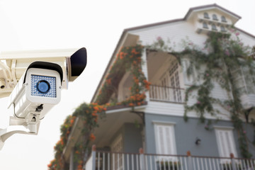 CCTV Security Camera operating on backyard roofing house.