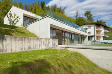concrete house with green lawn