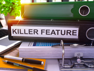 Black Ring Binder with Inscription Killer Feature on Background of Working Table with Office Supplies and Laptop. Killer Feature Business Concept on Blurred Background. 3D Render.