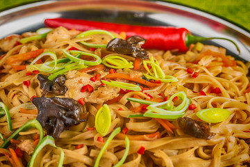 Asian noodles with mushrooms, herbs and chili
