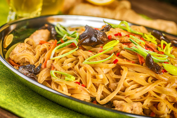 Asian noodles with mushrooms, herbs and chilli