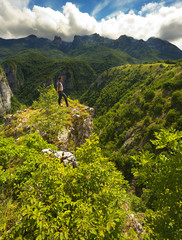 Man above Canyon of Komarnica River, Montenegro