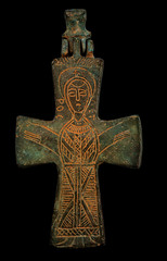 Ancient copper cross with sain image isolated on black