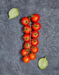 Tomatoes,  basil on a dark  background. Vegetarian food, healthy food concept.  Top view. Flat lay. Organic food.