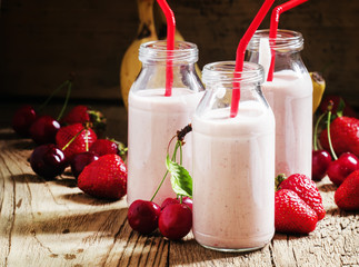 Strawberry Banana smoothie with cherry in glass bottles, vintage