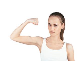 Beautiful girl showing muscles