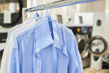 Weigh clean shirts on hangers in the Laundry room