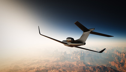 Photo of Black Matte Luxury Generic Design Private Jet Flying in Sky under the Earth Surface. Grand Canyon Background. Business Travel Picture. Horizontal, back angle view. Film Effect. 3D rendering.