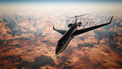 Photo Black Matte Luxury Generic Design Private Jet Flying in Sky under the Earth Surface. Grand Canyon Background. Business Travel Picture.Horizontal, front top angle view. Film Effect. 3D rendering.