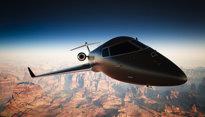 Closeup Black Matte Luxury Generic Design Private Jet Flying in Sky under the Earth Surface. Grand Canyon Background. Business Travel Picture. Horizontal, angle view. Film Effect. 3D rendering.