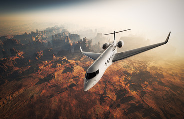 Photo White Glossy Luxury Generic Design Private Jet Flying in Sky under Earth Surface.Grand Canyon Background Sunrise. Business Travel Picture.Horizontal,Top Angle View.Film Effect. 3D rendering.