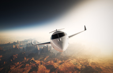 Photo White Glossy Luxury Generic Design Private Jet Flying in Sky under Earth Surface.Grand Canyon Background Sunset. Business Travel Picture.Horizontal,Front View.Film Effect. 3D rendering.