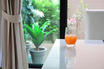 Orange juice put on white table outdoor background