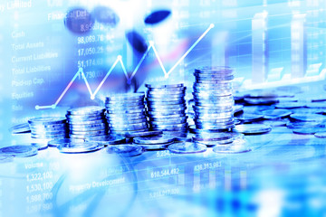 Coins stacked with falling moving for business financial and sto