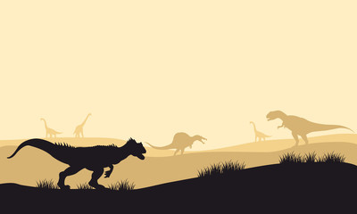 Silhouette of allosaurus at morning with fog