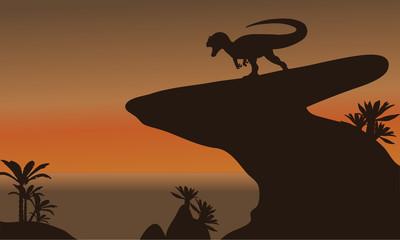 Silhouette of one allosaurus in cliff