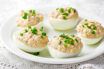 delicious stuffed eggs on white plate.