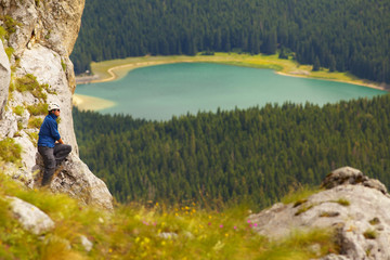 Tourist with Lake of Crno Jezero on Background, Durmitor, Monten