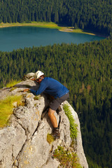 Climbing Tourist with Lake of Crno Jezero on Background, Durmitor, Montenegro