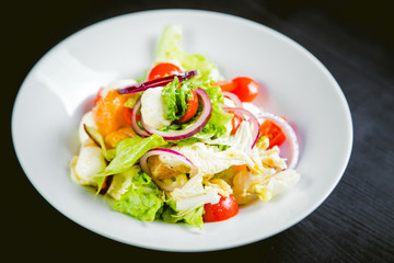 delicious vegetarian salad, salad with fruits and vegetables