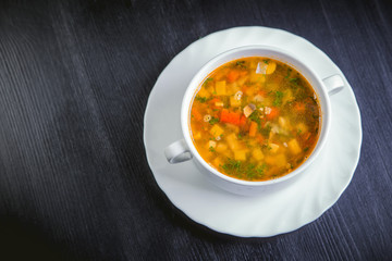 vegetable soup on the plate, delicious dish, food