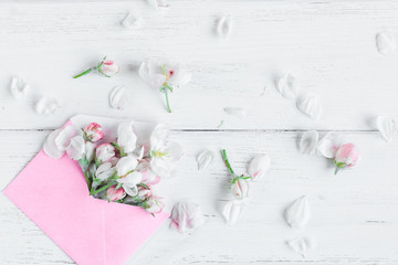 pink envelopes with flowers on white wooden background